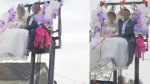 Đám cưới thót tim nhất Nghệ An: Cô dâu, chú rể ngồi vắt vẻo trên xe nâng cao quá mái nhà