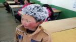 Bức ảnh cậu bé 'băng giá' hiếu học khiến hàng triệu người xem nhói lòng