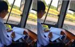Đình chỉ tài xế vừa lái xe vừa ghi chép sổ sách khi đang lưu thông với tốc độ cao
