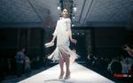 Người mẫu phi giới tính diện váy tua rua, tự tin sải bước trong show của NTK Patrick Phạm