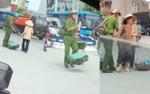 Nam sinh Học viện cảnh sát giúp đỡ các bà cụ gánh hàng qua đường giữa trưa nắng hè gây sốt mạng xã hội