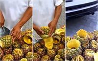 Người đàn ông gọt dứa nhanh như thái rau, vỏ vẫn còn nguyên không tỳ vết, 'nghệ' cả đầu bếp