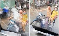Nam thanh niên chở bạn gái đuổi theo ném vỡ kính xe vì bị ô tô bắn nước bẩn lên người khi đi đám cưới