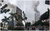 Cháy lớn tại tòa nhà đang xây dựng trên đường Hoàng Quốc Việt, hàng chục công nhân tháo chạy xuống đường