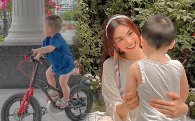 Lan Khuê khoe ảnh con trai một tuổi rưỡi nay đã cao lớn và biết chơi xe đạp