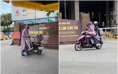 Giữa thời tiết 40 độ, người chồng mặc áo mưa dày cộm đến bệnh viện đón vợ, lí do đằng sau gây bất ngờ