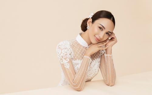 Hoa hậu Ngọc Diễm đẹp kiêu sa, gợi ý chọn áo dài cho các bà sui