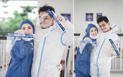 Tình yêu trong đại dịch Covid-19: Cặp đôi y tá chụp ảnh cưới trong bộ đồ bảo hộ