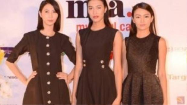Từ trái qua: Cao Ngân, Nguyễn Oanh, Mâu Thủy cùng đọ dáng. Cả ba chọn những chiếc váy đen theo kiểu dáng cổ điển truyền thống.