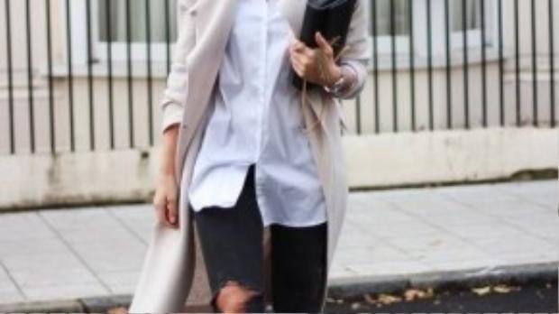 Bạn cũng có thể khoác thêm một chiếc áo vest dáng dài bên ngoài, khiến set đồ trở nên nổi bật và thu hút.