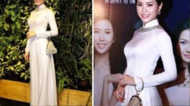 Sau khi đăng quang, á hậu Diễm Trang vẫn tiếp tục duy trì phát triển hình ảnh trong sạch. Kiểu tóc thắt bím cùng phụ kiện túi xách khiến bộ trang phục áo dài trắng đơn giản lại trở nên sang trọng.