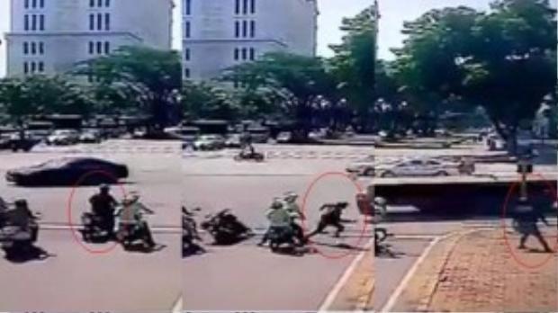 Khoảng khắc từ lúc bỏ xe máy đến chạy trên vỉa hè của anh chàng này chỉ trong vỏn vẹn 2 giây. (Ảnh chụp từ clip)