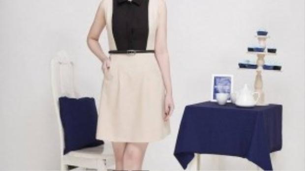 Chiếc váy chữ A tôn dáng cùng các đường cắt tinh tế và phối màu thanh nhã tạo nên một tổng thể nhẹ nhàng nhưng đủ ấn tượng với người đối diện.