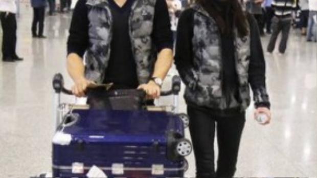 Lưu Thi Thi và Ngô Kỳ Long xuất hiện ở sân bay trong sự vắng lặng.