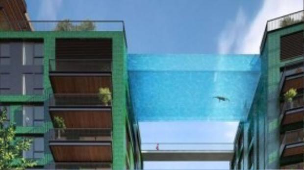 Bể bơi Sky (Anh): Bể bơi thuộc khu tổ hợp Embassy Gardens đang được thi công ở London này nằm ở độ cao 35 m, dài 27 m, rộng gần 6 m và sâu 3 m. Thành và đáy bể được làm từ kính dày 20 cm vắt ngang hai tòa nhà. Ảnh: Theresident.