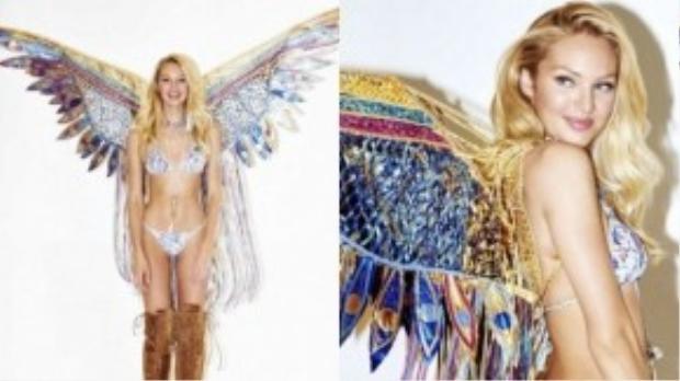 Người đẹp Candice Swanepoel tiếp tục tỏa sáng trong thiết kế với tên gọi Ảo giác du mục được kết từ những viên đá quý và lông vũ rực rỡ sắc màu sang trọng.