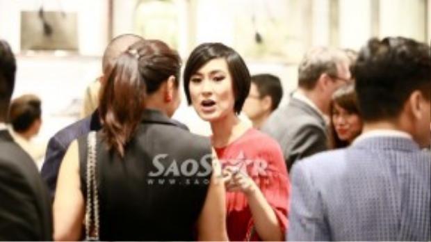 Kathy Uyên xuất hiện cùng người đàn ông lạ mặt tại một sự kiện.