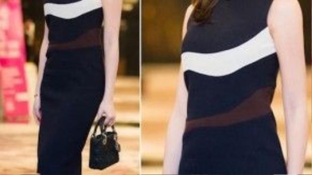 Đơn giản nhưng không kém phần thanh lịch và quyến rũ là cách ăn vận của Á hậu Huyền My. Một chiếc váy đen họa tiết ngang, kiểu dáng liền thân sẽ giúp chủ nhân khoe dáng nuột nà.