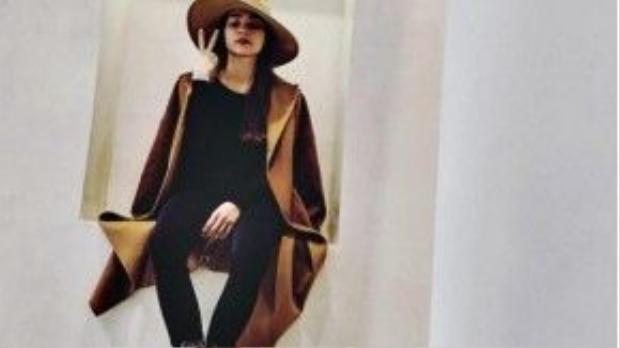 Cô bạn thân Hồ Ngọc Hà mix trench-coat màu camel ton-sut-ton với nón.