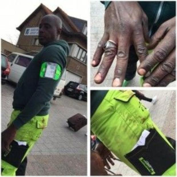 Bộ đồng phục và bàn tay dính đầy vết máu của Alphonse sau khi giúp đưa 7 nạn nhân bị thương đến nơi an toàn.