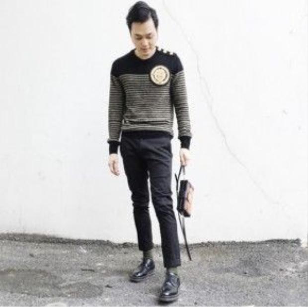 Quang Vinh có phong cách thời trang tinh tế, sành điệu.