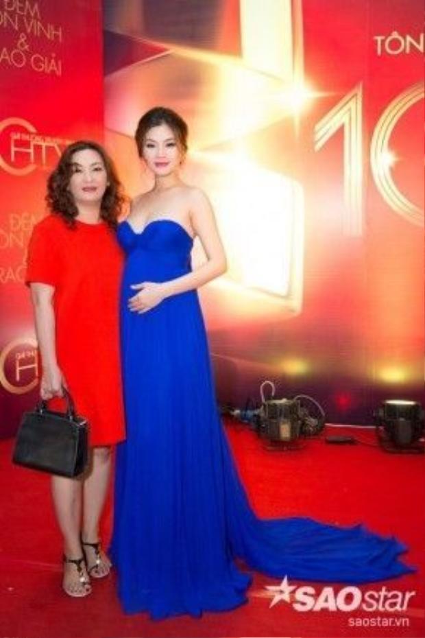Á hậu Diễm Trang dù đang mang thai vẫn cố gắng góp mặt trong sự kiện.