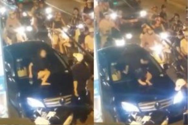 """Cô gái trèo lên nóc capo đập kính ô tô vì phát hiện người yêu chở """"bồ"""" đi chơi ngày 8/6"""