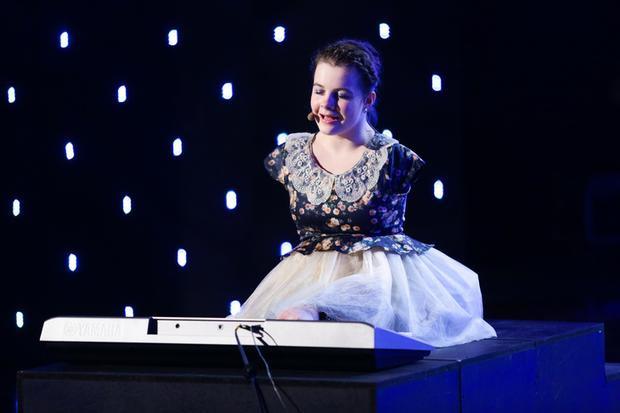 Cô bé Lorelai Mosnegutu với phần thi khiến khán giả xúc động trong chương trình.