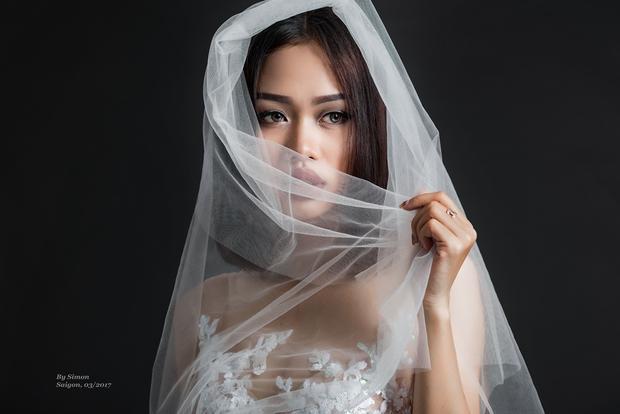 Mỹ Linh đầy lạnh lùng và thu hút khi hóa thành cô dâu trong bộ ảnh mới.