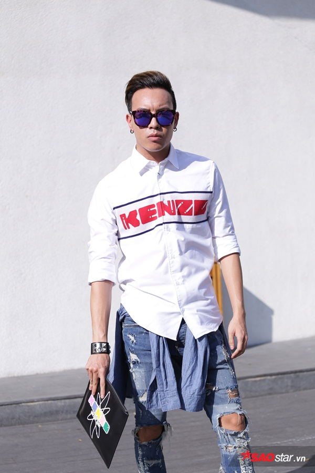 Trong khi đó, stylist Mạch Huy chọn áo sơmi và clutch Kenzo, giày boot Saint Laurent, vòng tay Hermes CDC, quần Zara và kính Gentle Monster