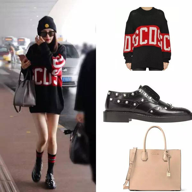 Thỉnh thoảng nữ diễn viên lại chuộng phong cách giấu quần với áo hoodie GCDS, giày Balenciaga GIANT với túi xách Michael Kors.