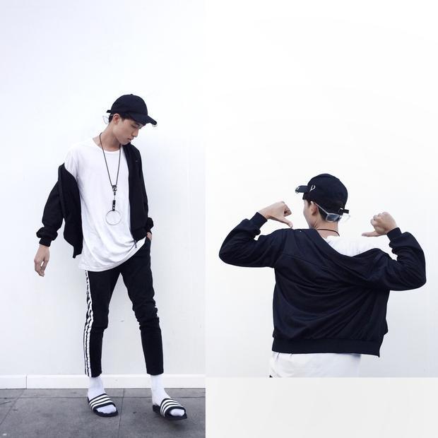 Stylist Duy Dương mang đậm phong cách sporty với quần thể thao 3 sọc trứ danh, áo khoác và một đôi dép lê - hot trend được rất nhiều các tín đồ thời trang trên thế giới lăng xê.