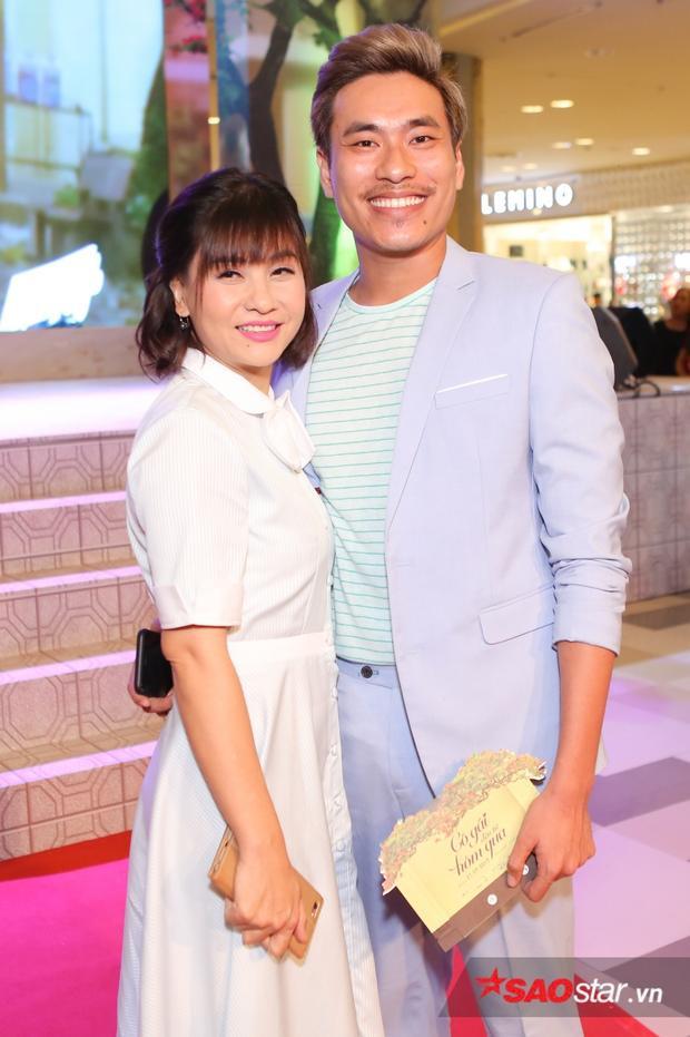 Cát Phượng bên cạnh bạn trai Kiều Minh Tuấn trong buổi ra mắt phim.