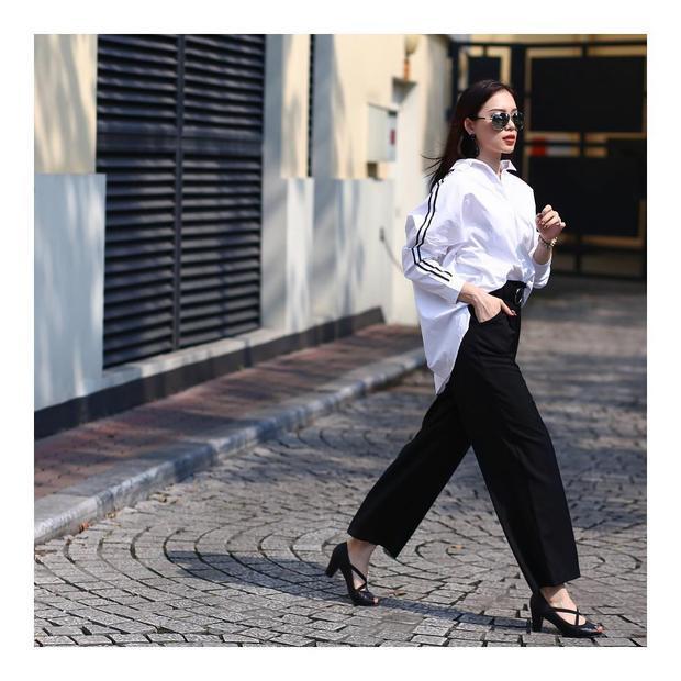 """Item """"khó trị"""" nhưquần oversize trousers có thể không giúp khoe triệt để đôi chân như mẫu quần short nhưng khi biết cách mix match lý tưởng cùng áo sơmi phom rộngcũngmang đến cho người mặc vẻ ngoài thời thượng."""