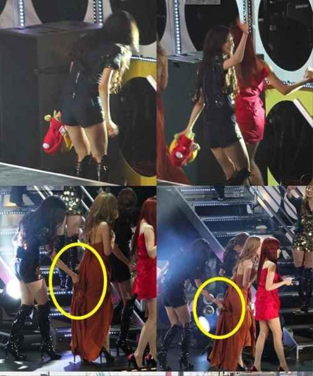 """Seohyun (SNSD) tiếp tục ghi điểm khi giữ váy cho trưởng nhóm Taeyeon tránh khỏi màn """"vồ ếch"""" vì diện trang phục quá dài."""