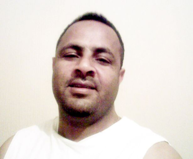 Endris Mohammed, kẻ đã mua xăng về thiêu chết con và vợ.