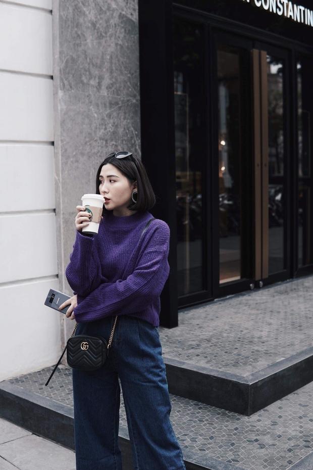 Heo Mi Nhon vô cùng thời thượng với combo cá tính, áo len và quần jean ống rộng kết hợp cùng túi Gucci mini, kính mát và chiếc Galaxy Note8 Tím Khói.