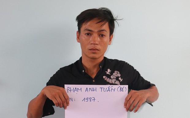 Đối tượng Phạm Anh Tuấn tại cơ quan công an. Ảnh: CAND
