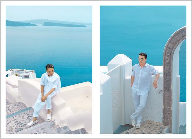"""Santorini với biệt danh """"đảo thiên đường"""" là địa danh du lịch nổi tiếng của đất nước thần thoại Hy Lạp. Vùng đất của những ngôi nhà hình nấm màu xanh colbalt là điểm đến hấp dẫn nhiều người và Đàm Vĩnh Hưng cũng là một """"fan cứng"""" của Santorini."""