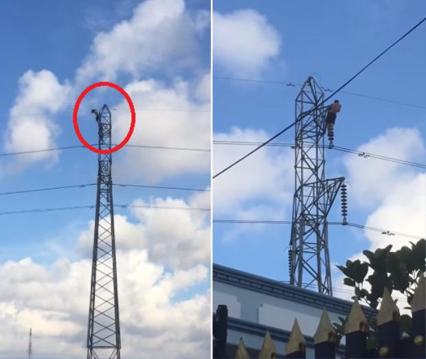 Thanh niên cố thủ trên cột điện cao thế nhiều giờ. Ảnh cắt từ clip.