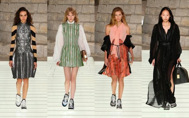 """Với cảm hứng từ trang phục hoàng gia Pháp từ nhiều thế kỷ trước, NTK Nicolas Ghesquière - Giám đốc Sáng tạo của Louis Vuitton đã khiến cho cả thế giới ngỡ ngàng khi ông """"dám"""" kết hợp giày sneakers với những bộ trang phục mang đậm dấu ấn quý tộc cổ điển được cách tân mang hơi thở đương đại."""