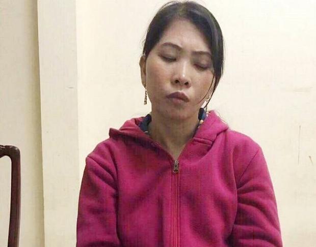 Nghi canHàng Thị Hồng Diễm tại cơ quan điều tra. Ảnh: VTC.