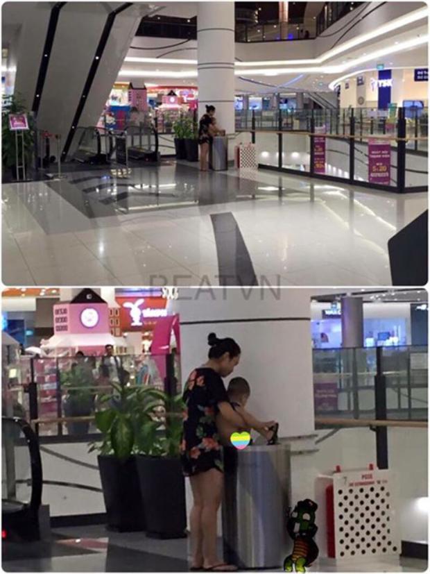 Bà mẹ trẻ thản nhiên cho con đi vệ sinh vào thùng rác công cộng tại trung tâm thương mại ở Long Biên.