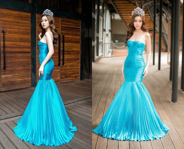 """Tại một sự kiện khác, hoa hậu gây ấn tượng bằng cách """"chơi trội"""" khi mặc chiếc đầm màu xanh biển nổi bật với kiểu dáng cúp ngực cùng phần dập ly cầu kì ở đuôi váy vô cùng lộng lẫy."""