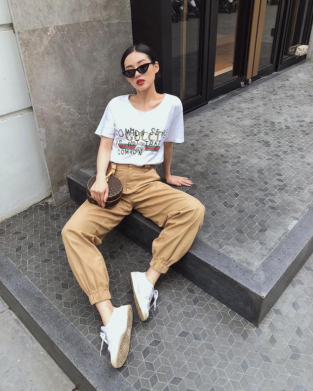 Khánh Linh thu hút trong set hàng hiệu với áo Gucci.