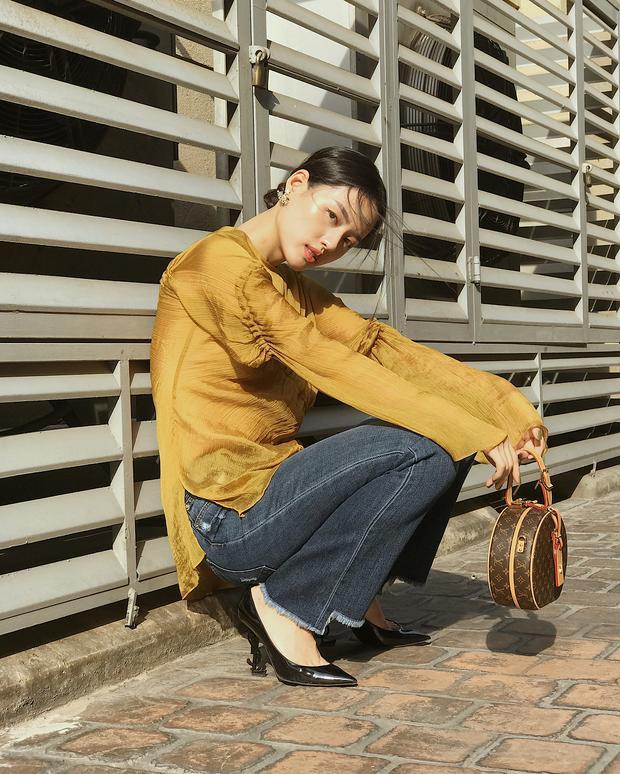 """Lắm lúc, Khánh Linh chọn phong cách cựa """"lady"""" với mái tóc búi."""