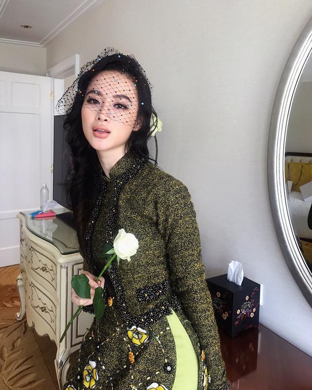 Angela Phương Trinh xuất hiện thần thái tà áo dài Công Trí, chiếc mạng che mặt tôn lên vẻ quyến rũ e ấp.