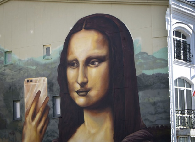 Bức tranh trên tường tòa chung cư ở trung tâm Kazan ngày 26/6.