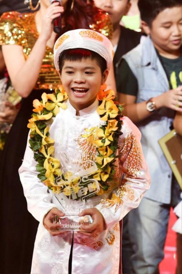quang Anh khi đoạt ngôi Quán quân Giọng hát Việt nhí mùa đầu tiên.