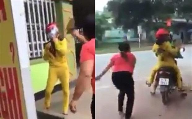 Người vợ (áo hồng) bắt quả tang cháu dâu (áo quần vàng) đi nhà nghỉ cùng chồng. Ảnh: cắt từ clip.